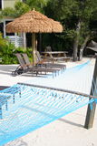 Capanna e hammock di Tiki Fotografia Stock