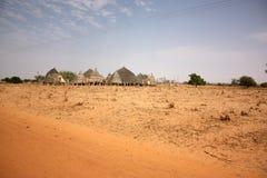 Capanne africane del villaggio Immagini Stock Libere da Diritti