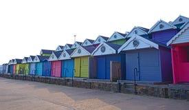 Capanne Colourful della spiaggia in Inghilterra Immagini Stock Libere da Diritti
