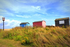 Capanne Colourful Littlestone Risonanza Regno Unito della spiaggia Immagini Stock Libere da Diritti