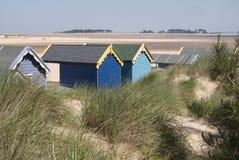 Capanne della spiaggia al Pozzi-seguente--mare, Norfolk, Regno Unito. Fotografia Stock