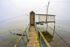 Capanne di pesca in valle di Comacchio, Italia Immagine Stock