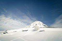 Capanne e montagne alpine Immagine Stock Libera da Diritti