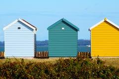 3 capanne variopinte della spiaggia della spiaggia Fotografia Stock