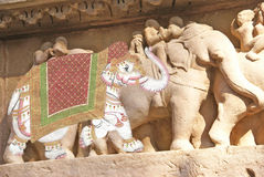 Caparisoned elephants. On temple sculpture in  India Stock Photo