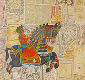 Caparisoned horse on parade. On Rajasthan tapestry background, India Stock Image