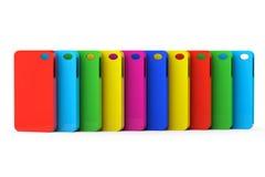Capas de plástico multicoloridos do telemóvel Imagem de Stock Royalty Free