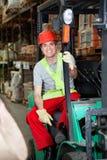 Capataz Sitting In Forklift en Warehouse imagen de archivo libre de regalías