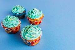 Capcake on a blue background, copy space royalty free stock photos