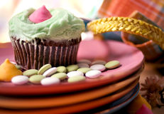 Capcake and Candy. Easter Cupcake with pastiles on dessert plates stock images