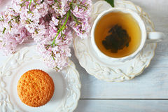 Capcake and cup of tea Stock Photos