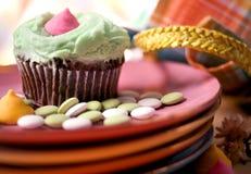 Capcake y caramelo Imagenes de archivo