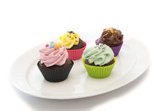 Free Capcakes On A White Dish Royalty Free Stock Photography - 23982127