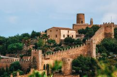 Capdepera castle on green hill in Mallorca island, Spain. Beautiful landscape with medieval architecture in Majorca Stock Photos