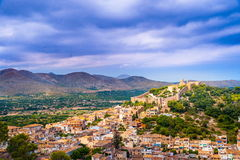 Capdepera castle in Mallorca island, Spain. Capdepera castle on green hill in Mallorca island, Spain Royalty Free Stock Image
