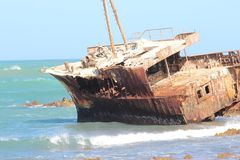 Cape Aghulas South africa stranded ship. At shore, rusty and broken royalty free stock photo