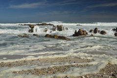 Cape Agulhas beach and waves. It is the most southern point of Africa where Atlantic and Indian oceans merge stock photo