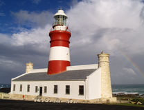 Cape Agulhas lighthouse and rainbow Royalty Free Stock Images