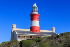 Cape Agulhas Lighthouse. The Cape Agulhas Lighthouse is situated at Cape Agulhas, the southernmost tip of Africa. It was the third lighthouse to be built in Stock Photo
