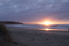 Cape Arago Sunset. The sun reflects on the ocean as it sets over Cape Arago State Park, Oregon stock photo