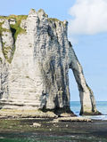 Cape with arch on beach of Etretat Stock Photos