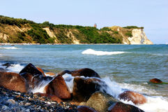 Cape Arkona. Cliffs on the Rügen island near cape Arkona with rocks, Baltic Sea and erratic blocks stock photo