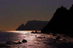 Cape Balyuzek. A full moon. Royalty Free Stock Photos