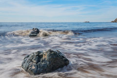 Cape Breton Oceanview. Mild waves lapping against the rocks Stock Image