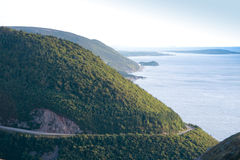 Cape Breton scenic road. View from Skyline trail of the ocean and scenic road in Cape Breton Highlands National Park, Nova Scotia, Canada royalty free stock photo