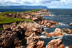 Cape Breton-White Point. The rugged coastline at White Point on northern Cape Breton Island, Nova Scotia, Canada, with the mountainous silhouette of Cape North Stock Photo