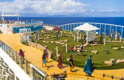 Cape Canaveral, USA - April 30, 2018: The upper deck with .mini golf court at cruise liner or ship Oasis of the Seas by. Royal Caribbean docked in Cape Stock Image