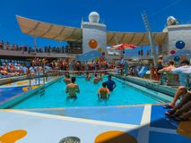 Cape Canaveral, USA - May 03, 2018: people playing at pool at upper deck in mini volleyball at cruise at cruise liner or stock image