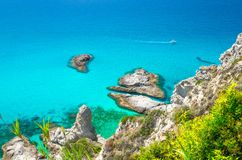Cape Capo Vaticano aerial panoramic view, Calabria, Southern Italy. Aerial view of amazing tropical blue azure turquoise sea water with yacht boat, rock cliff royalty free stock image