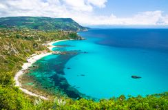 Cape Capo Vaticano aerial panoramic view, Calabria, Southern Ita. Aerial amazing tropical view of turquoise gulf bay, sandy beach, green mountains and plants stock photography