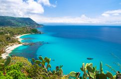 Cape Capo Vaticano aerial view from cliffs, Calabria, Southern Italy. Cape Capo Vaticano Ricadi aerial view from cliffs platform, sandy beach, green mountains stock photo