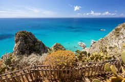Free Cape Capo Vaticano Ricadi In Italy, Calabria - Amazing Colors Of Sea, Blue Sky With White Clouds Background And Cactus Plants Royalty Free Stock Photos - 158684648