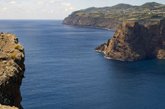 Cape and cliffs. The Sao Jorge coast in the Azores archipelago. Portugal royalty free stock photo