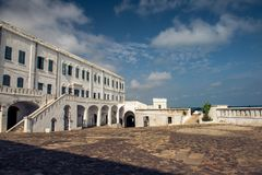 Cape Coast Castle in Ghana. A picture of Cape Coast Castle in Ghana Africa with a cloudy blue sky royalty free stock photography