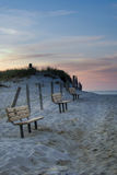 Cape Cod beach benches at Sunset Stock Image
