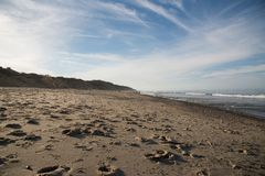 Cape Cod beach in late afternoon. Multiple footprints and an interesting sky at a Cape Cod beach in late afternoon Stock Photography