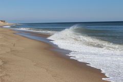 Cape Cod Beaches. Where the Atlantic Ocean meets Cape Cod results in crashing waves on the sandy beach of Nauset Stock Photo