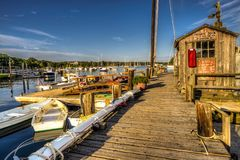 Cape Cod Boat dock. Cape Cod private wood boat dock with old sign stock image