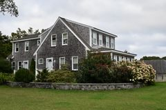 A Cape Cod Cottage. This is a Fall picture of a Cape Cod Cottage located on Cape Cod, Massachusetts.  This example of Cape Cod architecture features the Stock Photos