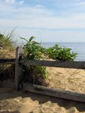 Cape Cod Fence Again. A view of the water in Eastham, Massachusetts on Cape Cod royalty free stock image