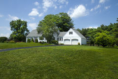 Cape Cod on Hill. Beautiful cape cod style home situated on slight hill Stock Image