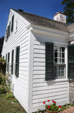 Cape Cod house. White Cape Cod house with green shutters in Wellfleet, Massachusetts Stock Images