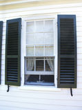 Cape Cod house. White Cape Cod house with green shutters in Wellfleet, Massachusetts Stock Image