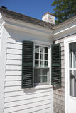 Cape Cod house. White Cape Cod house with green shutters in Wellfleet, Massachusetts Royalty Free Stock Image