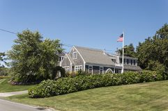 Cape Cod Home. Cape Cod Massachuttes style dream home on a beautiful day along the sea Royalty Free Stock Photos