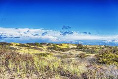Cape Cod National Seashore Nature. The sand dunes on the Cape Cod National Seashore in Truro Massachusetts on a sunny blue sky day royalty free stock image